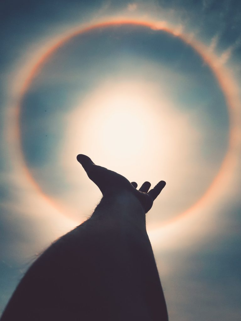 hand reaching sun